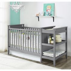 2-in-1 Convertible Crib and Changing Table Combo.