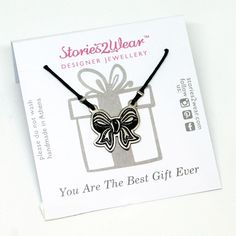 You're the best gift ever! Beautiful engraved bow necklace, wrapped around your neck. The necklace is accompanied by an illustrated card to make this personalis
