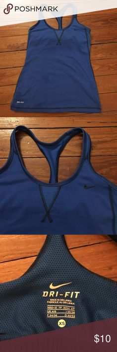 Nike Dri-fit razor back tank w built in bra xs This for a Nike Dri-fit razor back tank with built in bra. Size xs. This tank is a beautifu royal blue line with a navy blue. It's in great used condition and only has a small mark on the front that is not noticeable. It is pictured in the first picture. Nike Tops Tank Tops