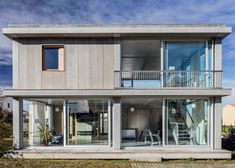 Both levels of this holiday house on Spain's Costa Brava feature rooms that can be opened, allowing residents to make the most of good weather