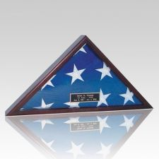 The Trooper Flag Display Case is manufactured in the US. The flag case is made from solid maple with dark cherry finish; it is assembled by hand utilizing a strong glued Dovetail joint system and then it is put through a seven step finishing process. This flag case is designed to display the American burial flag it can either be set on a flat surface or be wall mounted.
