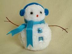 Muñeco de nieve con pompones