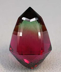 A stunning bi-color tourmaline acorn, cut by Pala International's Meg Berry. This stone won an AGTA Cutting Edge award in 1995. Photo: Wimon Manorotkul http://www.palagems.com/gem-news-2012-v2