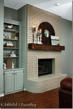 Update your fireplace with painted brick and a reclaimed wood mantle - Home Decoration and Diy Painted Brick Fireplaces, Paint Fireplace, White Fireplace, Fireplace Remodel, Fireplace Mantels, Fireplace Ideas, Basement Fireplace, Fireplace Brick, Cottage Fireplace