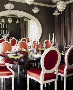 Beautiful dining room! Gray and persimmon. Modern yet traditional at the same time. Love the mirror!