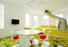 A slide into your dinning room? totally need one of these!! Plus love the crazy floor it's amazing.