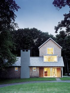 Love how the gable dormer sits above the ridge line kind-of deconstructed modern farmhouse.  LOVE this!