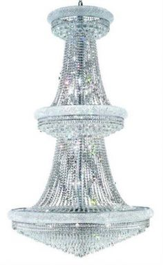 Adele - Large Hanging Fixture (38 Light Modern Grand Crystal Chandelier) - 1531G42. This Adele - Large Hanging Fixture  (38 Light Modern Grand Crystal Chandelier), is unmatched in its quality craftsmanship.  This elegant lighting fixtures, comes in a variety of finishes, crystal trims (including Heirloom Grandcut, Heirloom Handcut, Swarovski Elements & Swarovski Spectra) and crystal colors.  Finish, crystal trim and crystal color are all dependent on the model (check options). About The…