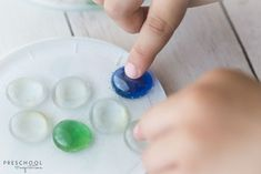 Putting glass beads on a lid for a glass gem and glue suncatcher