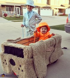 Susan: This is Lola (7) who is dressed as Harry Dunne and Bennett (16 months) dressed as Lloyd Christmas. We wanted to incorporate our wagon in their costume so we could...