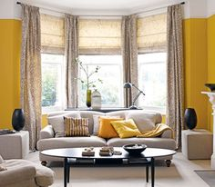Yellow room with beige and black decor