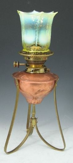 W.A.S. Benson & Co. brass and copper oil lamp,  No. 157, the frilled opalescent shade above an ovoid copper reservoir on three curved supports