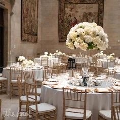 Peony centerpieces with clear vases so you don't block the view of other guests at the table