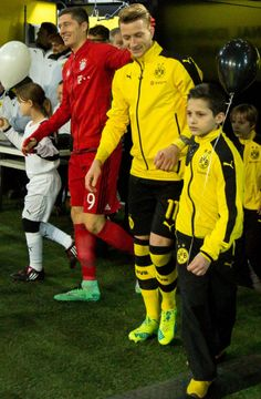 Robert Lewandowski and Marco Reus.  Neither of the kids with them has any time for this reunion!