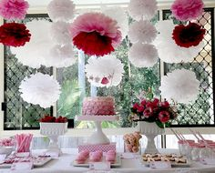 """Pink ruffle cake (easy decorating) with homemade paper doll clothesline """"bunting"""" on top"""