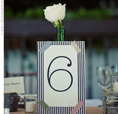 card printed table numbers with black and white stripes