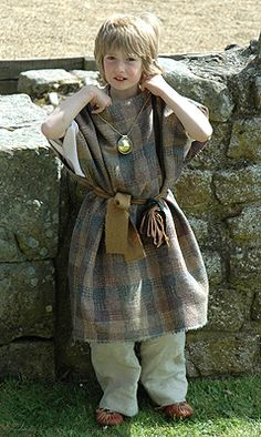 This is a modern representation of a Roman Child's outfit in the provinces of rome. Child Wearing Bulla. 2008. Photograph. Illustrated History of the Roman Empire. 08 June 2008. Web. 25 Sept. 2011. .