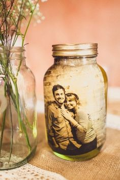 laminate sepia pictures and put in mason jars of water by Amy Claire