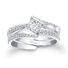 Princess Cut Bridal Set - 7880SW - Stunning and unique this interlocking diamond wedding set exudes confidence for the woman who wears it. Featuring a low profile cathedral shank engagement ring that rises to capture the channel set princess diamond center securely in it's grasp, while pave set diamonds cascade down the shoulders. A pave set diamond wedding ring slips into the split open shank.   Also available in 18K and Platinum