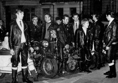 """Rockers at the Fifty-Nine Club in Paddington, London with Father Bill.""  Lots of Teddy Boys had Bikes in the fifties, the rocker style was born from the Teds who wore Drapes at weekends but leathers on the bike, by the early 60's Rockers were a major style. A trip to the Ace Cafe in London is well worth a visit to learn about Rockers."