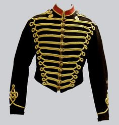 """Jacket - Victorian Horse Artillery, Full Dress, c. 1890.  From website: """"Black wool; extensive gold-coloured cotton braid; frogging in front; scroll design at back and sleeves. Body of jacket and collar completely edged with same braid. Stand collar with insert of red fabric."""""""