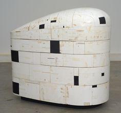 sculpture by Hiroyuki Hamada,  (2006-10). Burlap, enamel, oil, plaster, resin, tar, wax and wood, 45 x 40 x 24 inches