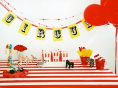 Day at the Circus Kids' Birthday Party :  When planning the decor for a party, add a banner or two to your list. They make a big impact, changing any interior space from everyday to extra special.  A few great ideas on this one