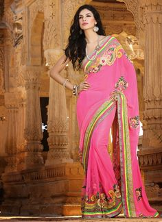 This Eye-Catching Elegant Drape Is Perfect For Any Occasion. Outstanding Craftmanship Of Embellishments Exhibited In This Pink Faux Georgette Saree. The Brilliant Attire Creates A Dramatic Canvas With Amazing Bead, Resham, Stones & Unique Border Work Work.
