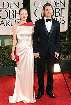 """Here comes the...nominee! A slash of red was all it took to wow best-dressed lists when Angie showed up in perfectly tailored white satin Atelier Versace at the Golden Globes in January. She may not have gone home with a gold statue (her film """"In the Land of Blood and Honey"""" lost to """"A Separation"""" for best foreign language Film), but she went home with Brad. Winner's circle, indeed."""