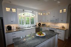 Custom White Kitchen with Scottish Meadow Granite tops