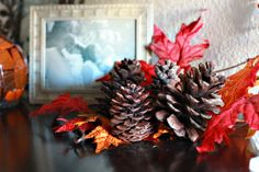 Green decor for Fall or Thanksgiving taken from nature. You can make this beautiful Fall leaf and pinecone centerpiece as well.