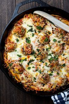 Cheesy baked spaghetti and meatballs is a fancy and delicious take on classic spaghetti and metaballs. Spaghetti tossed in marinara and baked with simple homemade meatballs with a melted layer of an Italian blend of cheeses. The pasta has an amazing overall thicker texture thanks to baking in a skillet. Easy to make in almost one pan and the whole family will devour. #spaghettiandmeatballs #homemademeatballs #bakedpasta