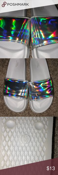 Holographic pool slides These Holographic pool slides came from urban outfitters. They are a size 10, and they're great for lounge shoes, maybe get in the mail, and you don't feel like putting on socks and shoes. Urban Outfitters Shoes Sandals
