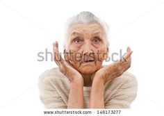 very old woman beng surprised by something  - stock photo