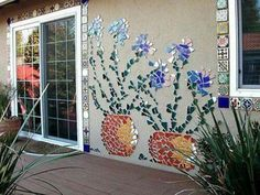 Mosaic mural made from broken tiles or dishes.