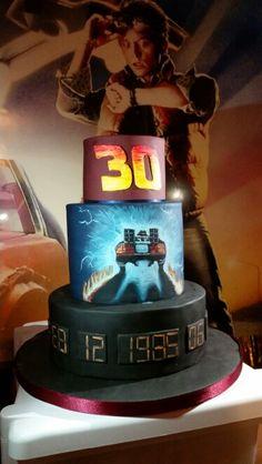 Back to the future cake 80 's birthday party. Hand painted Delorean time machine. Marty Mcfly  Www.emilyspillmancakes.co.uk  Www.facebook.com/emilyspillmancakes