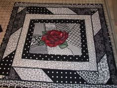 *Fabric artist Marcella Brown has just recently created this Zentangle® quilt.  Marcella, as always, creates beauty with good design and color.   The rose bursting through on a black and white pattern looks not only fashionable, but symbolic of love bursting through a landscape of that might seem broken and complex.