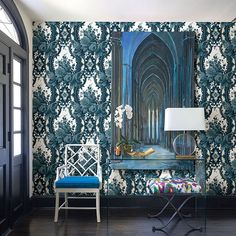 Surface printing gives a raised texture to certain details of this wallpaper. The floral damask pattern is dreamy in shades of blue on white. Dreamer is a non woven, unpasted wallpaper. Call toll free 877-316-9930 for immediate help.