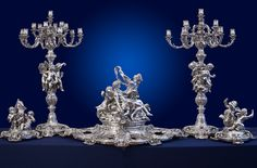 OF ROYAL IMPORTANCE, A MASSIVE FIVE-PIECE FRENCH SILVER CENTERPIECE AND CANDELABRA GARNITURE EXHIBITED AT THE PARIS INTERNATIONAL EXHIBITION 1878 MARK OF ODIOT, PARIS, CIRCA 1878 THE ROYAL HOUSES OF FRANCE AND DENMARK EXHIBITED AT THE PARIS INTERNATIONAL EXHIBITION 1878. MARK OF ODIOT, PARIS, CIRCA 1878 Executed by the sculptor Francois Gilbert. Odiot worked with Gilbert over a number of years and used many of his designs, especially for his grandest commissions.