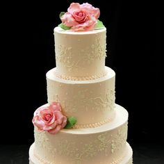 A simple and elegant buttercream design, highlighted with hand made sugar roses.