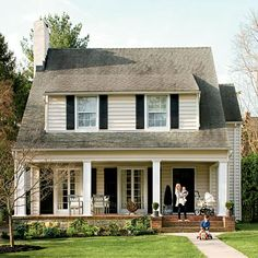 Cottage style home. Change the pitch of our roof add porch and dormers to make it similar to this.
