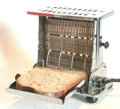 Drop side toaster - Played with one of these that had been replaced by a newer version of the pop-up variety in the early 50s