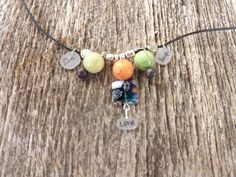 Beaded Live LaughLove black waxed linen by LukaLaneJewelry on Etsy  Love the colors and construction of this necklace!