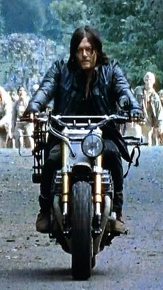 You will never be this badass. Only Norman Reedus can lead thousands of zombies while driving slowly on a motorcycle.