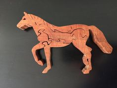 Horse puzzle made with either walnut or oak wood
