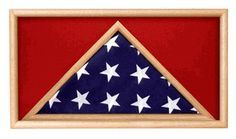 This Veterans Depot Rectangular Flag Memorial Case is hand crafted out of solid oak that has a high gloss finish with a lightweight acrylic front panel. This beautiful case is perfect for displaying your special 5' x 9.5' flag and any other memorabilia, such as medals, rank insignia, patches, pins and more. Included are a wall hanging kit and complete care instructions. You may also add an engraving plate that you may mount wherever you like on the case.