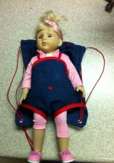 Draw string backpack with a carrier for those 18' dolls that I see moms carrying around!!