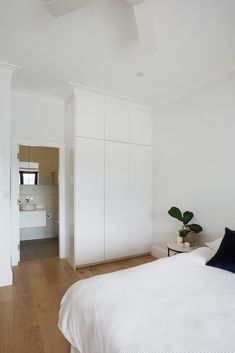 Bright airy bedroom featuring white custom wardrobes leading into a designer bathroom, all joinery work by Braeside Joinery. Complemented by wooden floorboards, detailed cornices. All the finishing touches Airy Bedroom, Cornices, Open Fires, Timber Flooring, Beautiful Lights, Joinery, Cottage Style, Wardrobes, Living Spaces