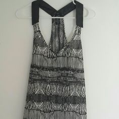 Black & white racer back tank Sheer, black and white patterned racer back tank with faux leather straps. High-low length with the back being tunic length. Worn twice and is in excellent condition with no signs of wear. Pet free and smoke free home. Rue 21 Tops Tank Tops