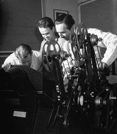 Walt and animators looking over footage from Pinocchio, 1939